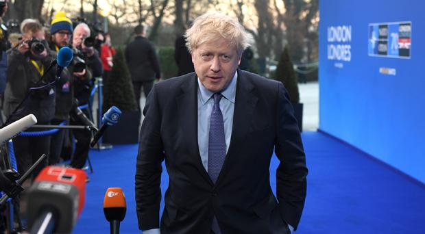 Prime Minister Boris Johnson arrives for the annual Nato heads of government summit at The Grove hotel in Watford, Hertfordshire (Chris J Ratcliffe/PA)