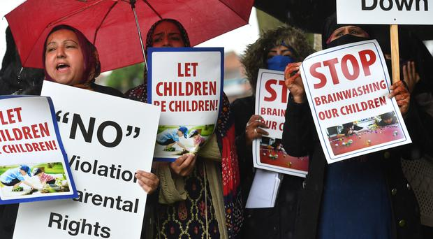 Protesters hold their first demonstration since an injunction was granted barring action immediately outside Anderton Park Primary School, in Moseley, Birmingham, over LGBT relationship classes (Jacob King/PA)