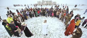 Crowds gather to celebrate the Winter Solstice in 2009 (Ben Birchall/PA)