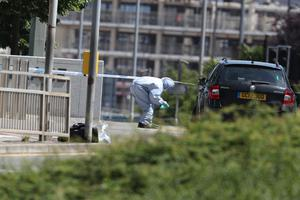 Police forensics officers at work near Forbury Gardens in Reading (Steve Parsons/PA)