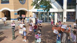 Undated handout photo of parents and children staging a protest outside a West Sussex County Council building after plans to get children back to school were rejected (Mary Bennison/PA)
