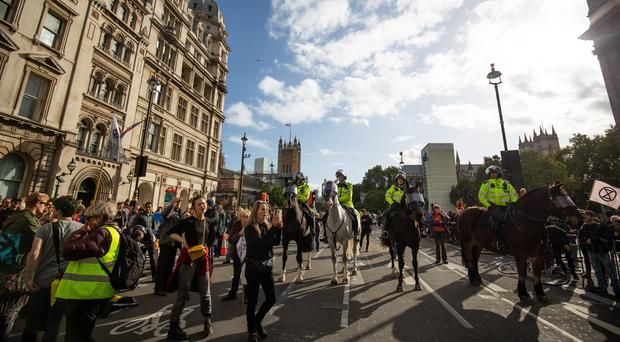 Climate change protesters outside the Palace of Westminster during an Extinction Rebellion protest in central London (Aaron Chown/PA)