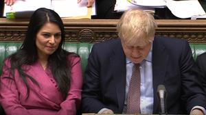 Priti Patel and Boris Johnson during Prime Minister's Questions in the House of Commons (House of Commons/PA)