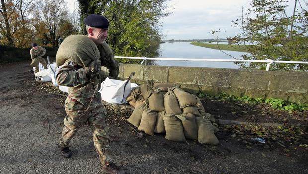 A soldier carries sandbags at a bridge at Stainforth, near Doncaster (Danny Lawson/PA)