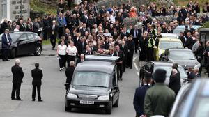 Mourners follow the funeral procession of Manchester bomb victim Eilidh MacLeod after the service at Church of Our Lady, Star of the Sea, in Castlebay on the island of Barra (Andrew Milligan/PA)