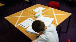 Social distancing measures as a child studies on a marked table at Kempsey Primary School in Worcester. Nursery and primary pupils could return to classes from June 1 following the announcement of plans for a phased reopening of schools.