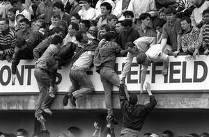 Football supporters being lifted to safety