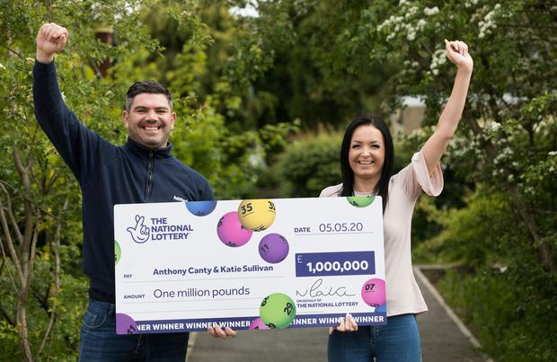Anthony Canty celebrates with his partner Katie Sullivan (National Lottery/PA)