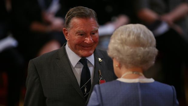 Dennis Goodwin is made an MBE by the Queen at Buckingham Palace (Johnny Green/PA)