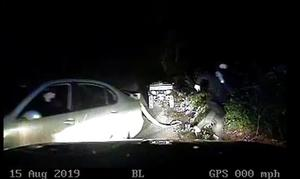 Jessie Cole, in a balaclava, was caught on police car footage as he unhooked a stolen quad bike and ran in Admoor Lane, Berkshire (Thames Valley Police/PA)
