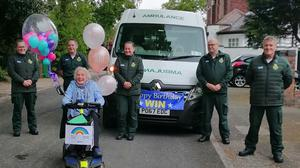 Ambulance workers with Win Page, from Middleton, Greater Manchester, during her fundraising walk (Handout/North West Ambulance Service NHS Trust/PA)