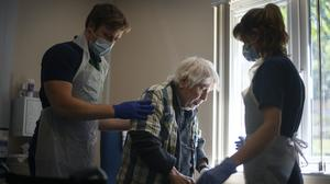 Rehab Support Workers perform a physiotherapy treatment on patient Michael Kidd, 82 (Victoria Jones/PA)