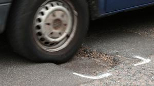 Potholes can cause damaged shock absorbers, broken suspension springs and distorted wheels (Yui Mok/PA)