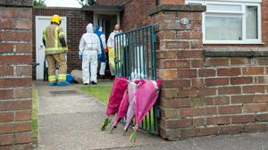 The bodies of a man and a woman were discovered in the property (Joe Giddens/PA)