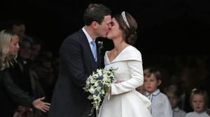 Princess Eugenie and Jack Brooksbank kiss on the steps of St George's Chapel in Windsor Castle after their wedding ( Steve Parsons/PA)