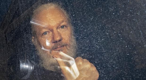 Julian Assange claims he was spied on while he lived in the Ecuadorian embassy in London (Victoria Jones/PA)