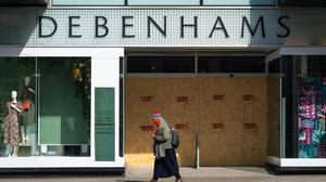 A person walks past a boarded up Debenhams, Oxford Street, London. The retailer is to cut 2,500 jobs (AAron Chown/PA)