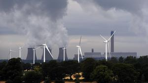 Emissions have fallen in the UK in part due to a switch to renewables (John Giles/PA)