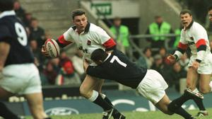 England's Jon Sleightholme is tackled during a 1997 Five Nations game (Adam Butler/PA)