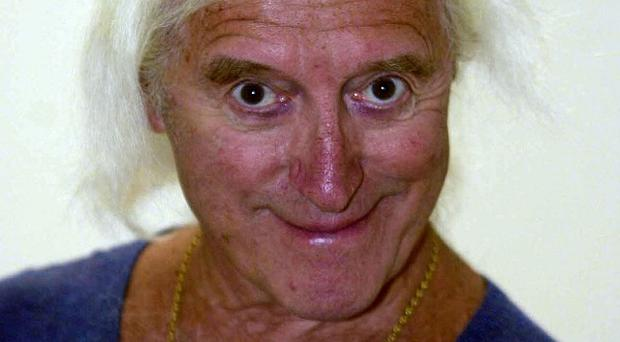 Police investigating allegations linked to Jimmy Savile, pictured, and others have arrested a 65-year-old man in south London