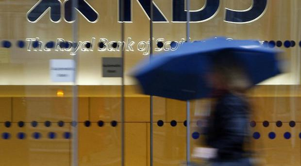 File photo dated 03/12/09 of a woman walking past the headquarters of the Royal Bank of Scotland in the City of London, as RBS will reportedly face criminal charges and a £500 million fine for its role in the Libor rate-rigging scandal this week. PRESS ASSOCIATION Photo. Issue date: Sunday February 3, 2013. The taxpayer-backed lender is likely to announce the settlement with the Financial Services Authority and American regulators on Wednesday, according to The Sunday Times, with the head of the groups investment bank, John Hourican, also expected to confirm his departure. See PA story CITY RBS. Photo credit should read: Johnny Green/PA Wire