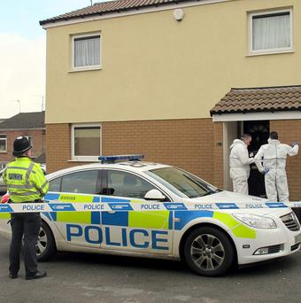 Forensic police at a property in Miranda Close in Frankley, Birmingham, where a couple were found dead