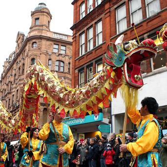 Performers take part in a parade in central London to celebrate the Chinese New Year