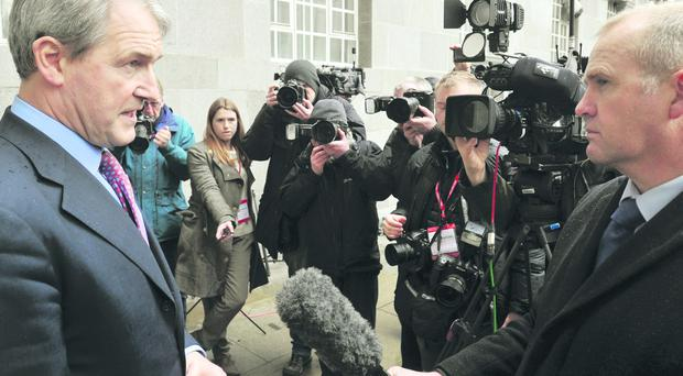 Secretary of State for Environment, Food and Rural Affairs Owen Paterson speaks to the media outside Defra Headquarters, London, after meeting with representatives of the food industry at the weekend