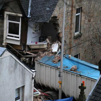 The scene of an accident where a lorry crashed into a house in Fairlie, North Ayrshire, killing a woman