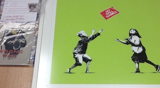 Original Banksy piece Wrong War and signed print No Ball Games were recovered by police in Greenwich, east London (Met Police/PA)