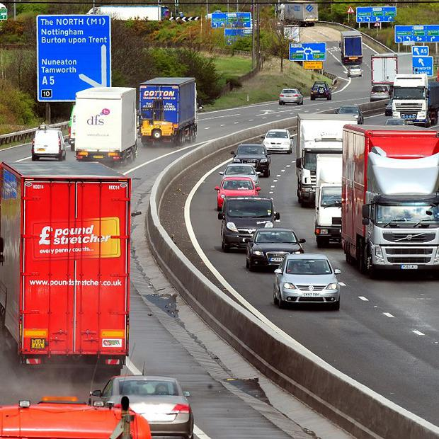 A man died after falling from a motorway bridge on to the road below in Birmingham