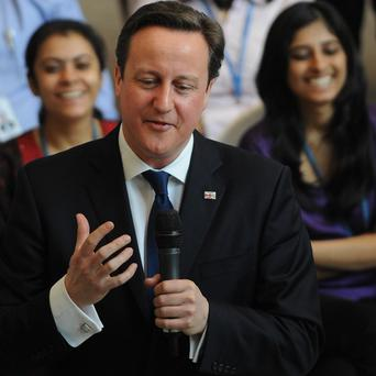 Prime Minister David Cameron holds a question and answer session with Unilever employees at their headquarters in Mumbai