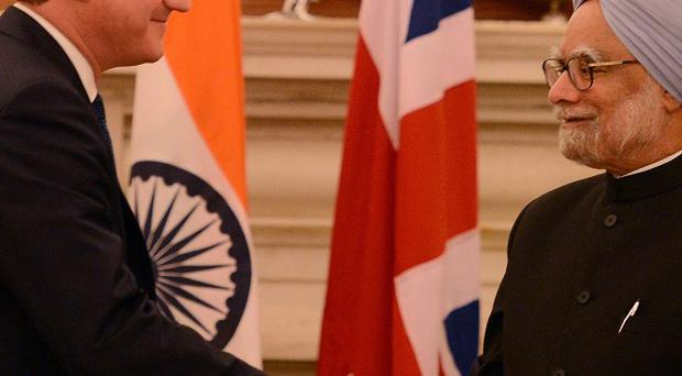 David Cameron meet India's Prime Minister Manmohan Singh in New Delhi on the second day of his three-day visit to India