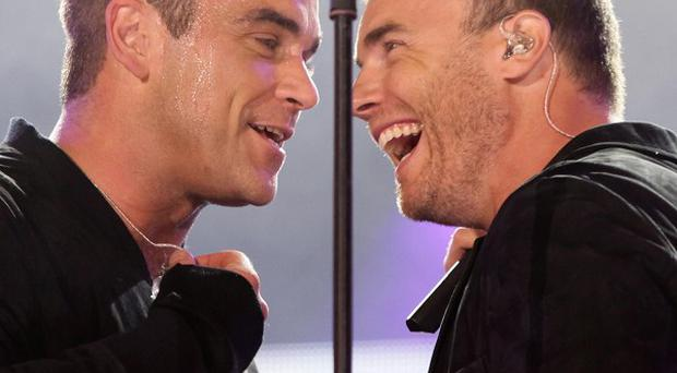 X Factor bosses are said to be considering plans to line up Gary Barlow, right, and Robbie Williams on the next series