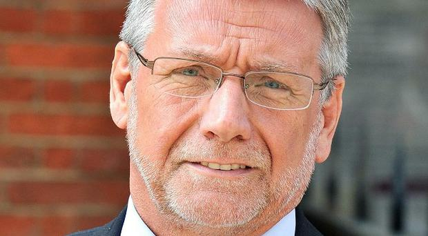 Neil Wallis, former deputy editor of the News of the World, has spent nearly two years on police bail