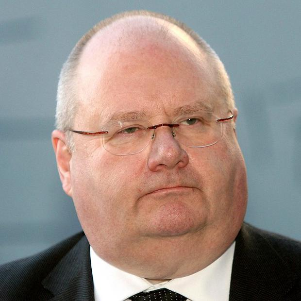 Eric Pickles faces a significant revolt by town halls over council tax, a survey shows
