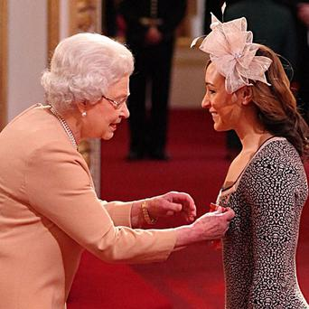 Jessica Ennis receives her Commander of the British Empire (CBE) medal from Queen Elizabeth II during Investiture ceremony at Buckingham Palace, London. PRESS ASSOCIATION Photo. Picture date: Thursday February 28, 2013. See PA story ROYAL Investiture. Photo credit should read: Lewis Whyld/PA Wire