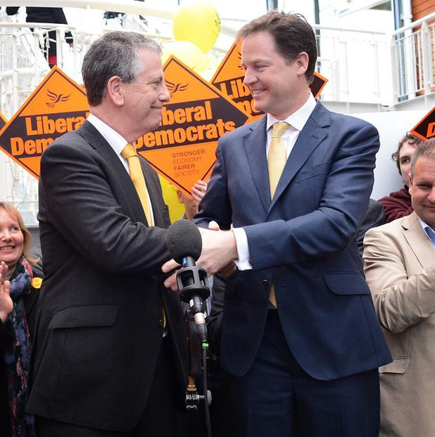 Liberal Democrat leader Nick Clegg congratulates Mike Thornton on winning the Eastleigh by-election