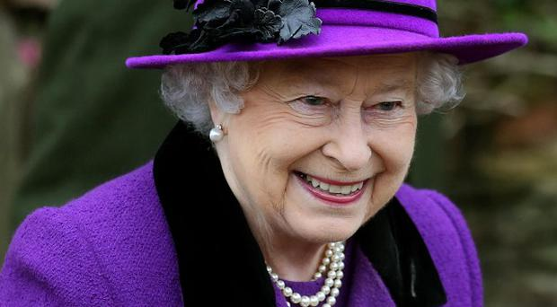 The Queen is said to be in 'good spirits' after being admitted to hospital with symptoms of gastroenteritis, Buckingham Palace said