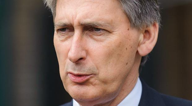 File photo dated 20/07/12 of Defence Secretary Philip Hammond, who has warned he will resist further cuts to the armed forces in Chancellor George Osborne's forthcoming spending review. PRESS ASSOCIATION Photo. Issue date: Saturday March 2, 2013. See PA story POLITICS Defence. Photo credit should read: Dominic Lipinski/PA Wire