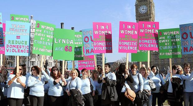 A group of women marched across Westminster Bridge to commemorate those who have died as a result of domestic violence