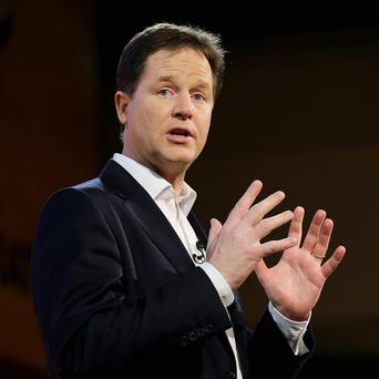 Liberal Democrat leader Nick Clegg addresses the opening rally of the party's spring conference in Brighton