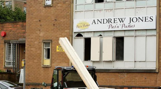 Emergency services outside Andrew Jones Pies in Huddersfield where David Cole died following an oven explosion