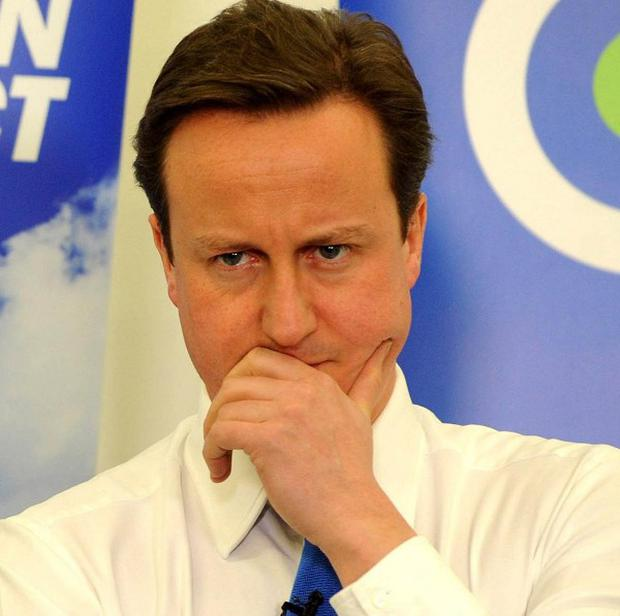 David Cameron's personal rating dropped eight per cent in a fortnight to 18 per cent