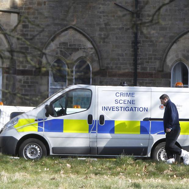 A view of CSI vans at the Jamea al Kauthar school in Lancaster, where specialist female police officers are conducting searches