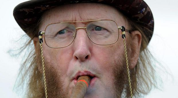 Racing pundit John McCririck is recovering in hospital tonight after falling ill during the first day of the Cheltenham Festival