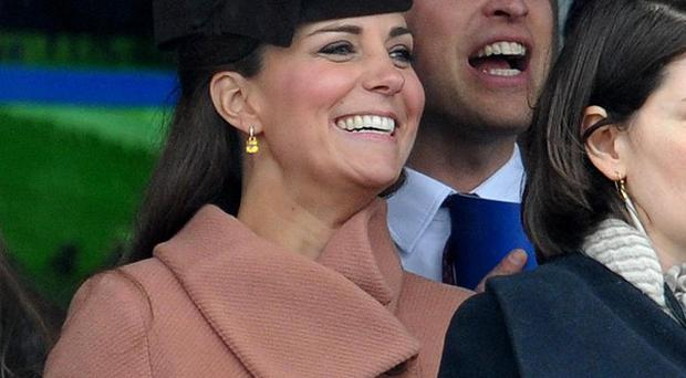 The Duke and Duchess of Cambridge watch the second race during Cheltenham Gold Cup Day