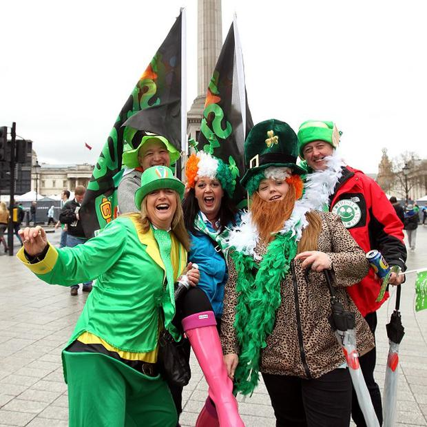 Revellers watch the St Patrick's day parade and festival in Trafalgar Square
