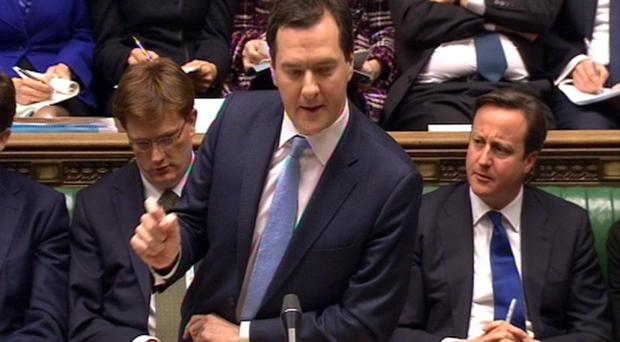 Chancellor George Osbourne delivers his budget to the House of Commons in Westminster, London
