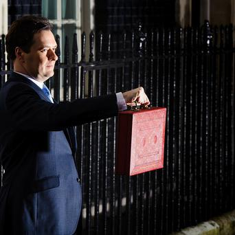 Chancellor of the Exchequer George Osborne gets ready to deliver his annual Budget statement